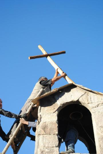 Putting the cross on the new chapel.